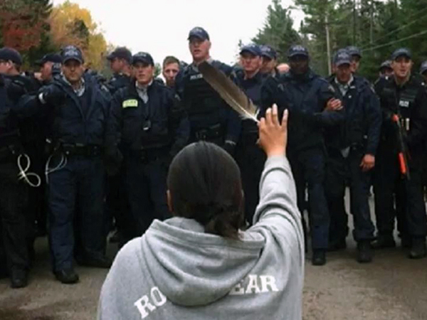 Amanda Polchies, in a famous image from the 2013 shale gas protests in Kent County. (CBC)